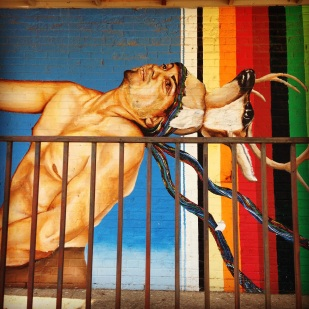 One of many lively and mildly disturbing murals in Dallas, TX.