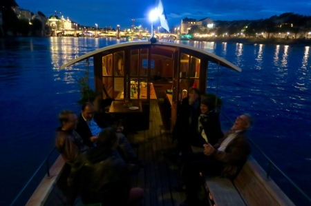 A late-night dinner party on an old ferry boat. Basel, Switzerland.